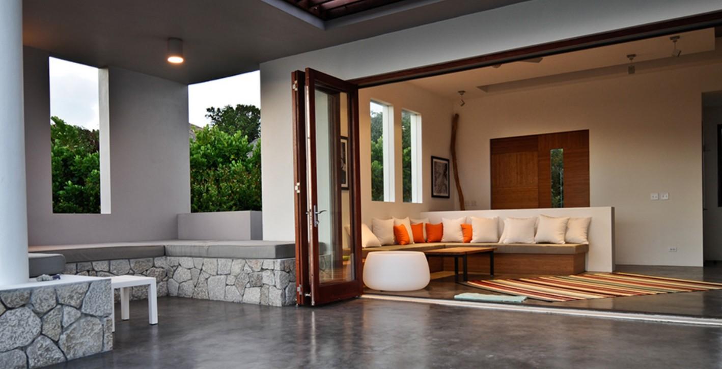 Lacatina folding patio doors design build planners for Patio door designs