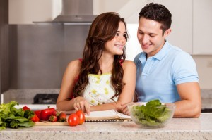 http://www.dreamstime.com/stock-photography-finding-right-recipe-dinner-young-hispanic-couple-cooking-together-looking-cookbook-new-image33775232