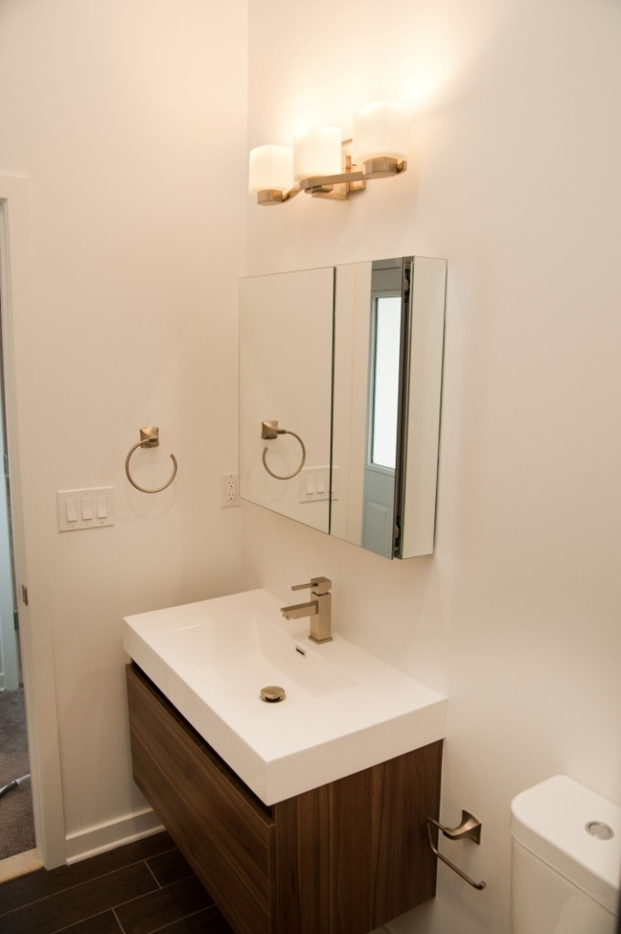 Floating bathroom vanity design build pros for Bathroom design build