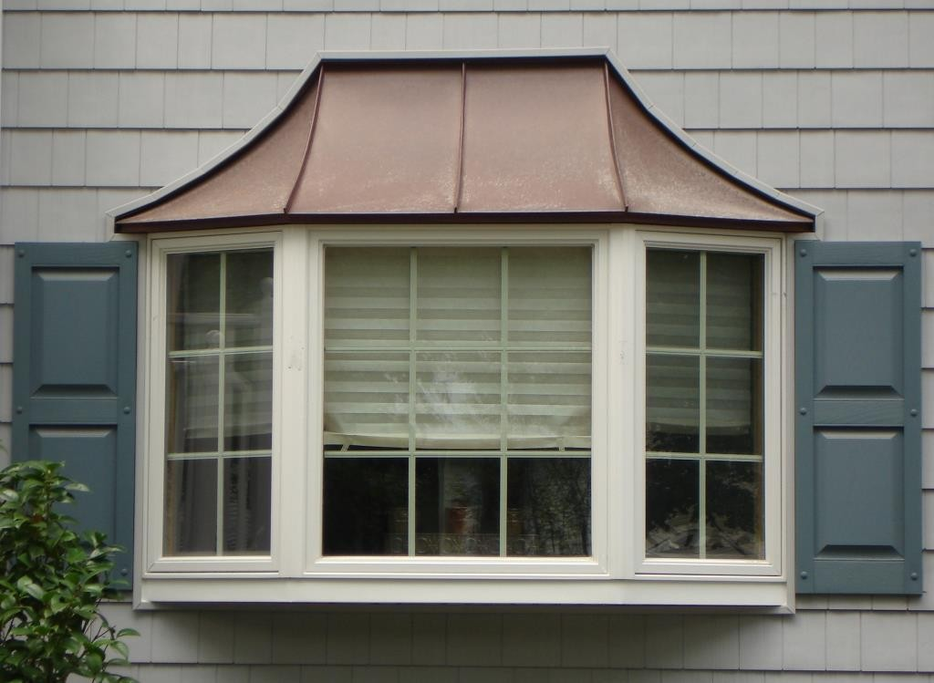 The difference between a bow and bay window design build for Bay window design