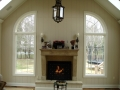 andersen-arch-top-windows-flanking-a-fireplace-in-shrewsbury-nj