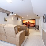 Basement renovation featuring home theater (1)