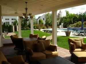 outdoor-living-space-with-a-fireplace-and-a-TV-300x225