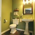 Green walls in a powder room remodel