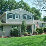 Green shutters with viyl shake siding for an exterior makeover