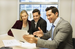 http://www.dreamstime.com/royalty-free-stock-photography-architect-presenting-new-project-to-smiling-young-couple-men-woman-banker-tablet-pc-desk-contract-image36095247