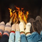 Feet warming near the fireplace