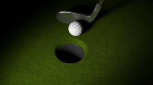 Golf ball with club on putting greens with hole