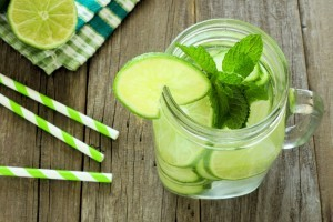 Detox water with lime and cucumbers in a mason jaCucumber Water recipe from Organic Gurlz Gardens of Fort Wayne Indiana